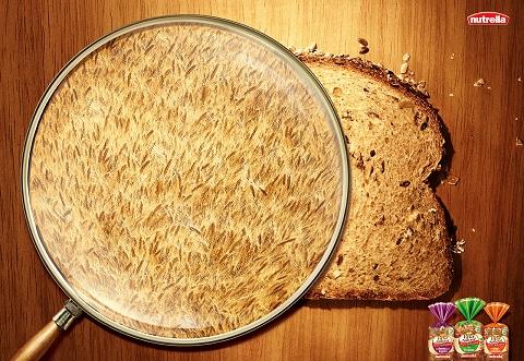↑ ごく普通の食パン。虫眼鏡で拡大して見ると……パンの生地が無数の小麦の穂で出来ているという次第