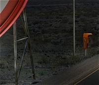 電話ボックスと交通標識の足の部分