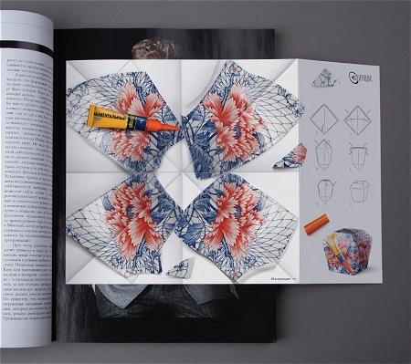↑ 雑誌に折り込まれた、割れた花瓶と接着剤の広告。右側には折り方を指示する説明書き。