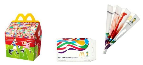 ↑ 今回のハッピーセット「FIFA ワールドカップ応援グッズ」の専用ボックスとグッズ一例